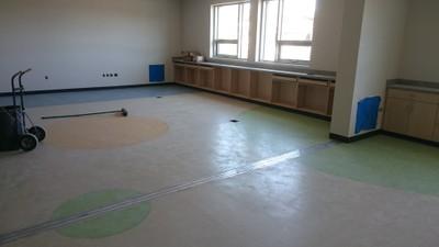 April 6, 2016 - Flooring installation underway
